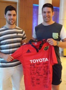 Billy Holland, Munster player and EWB-Ireland board member, presenting the jersey to volunteer Colm Coffey.